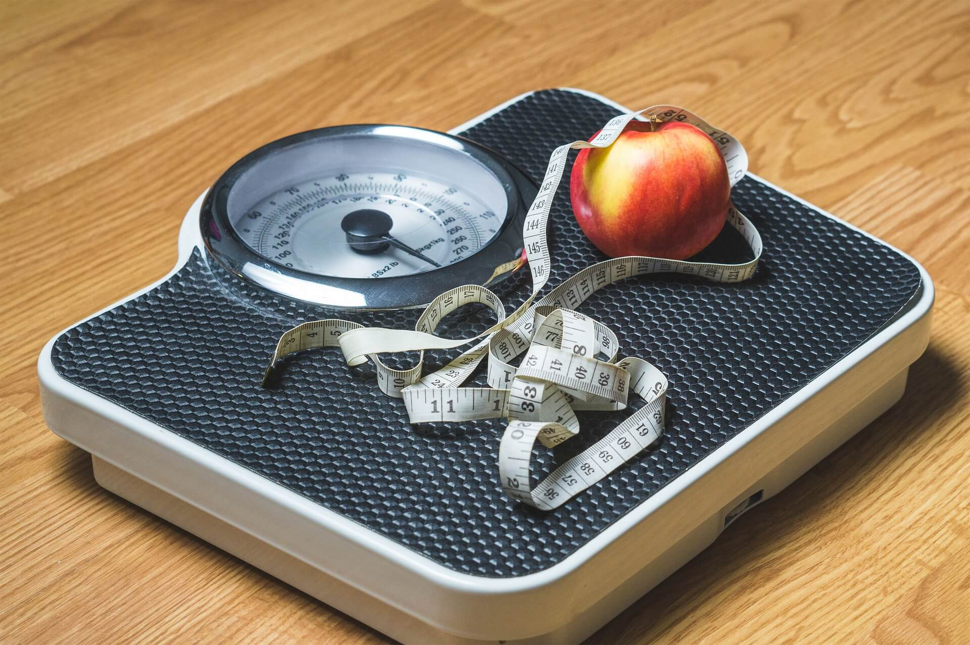 weight scale and an apple on it