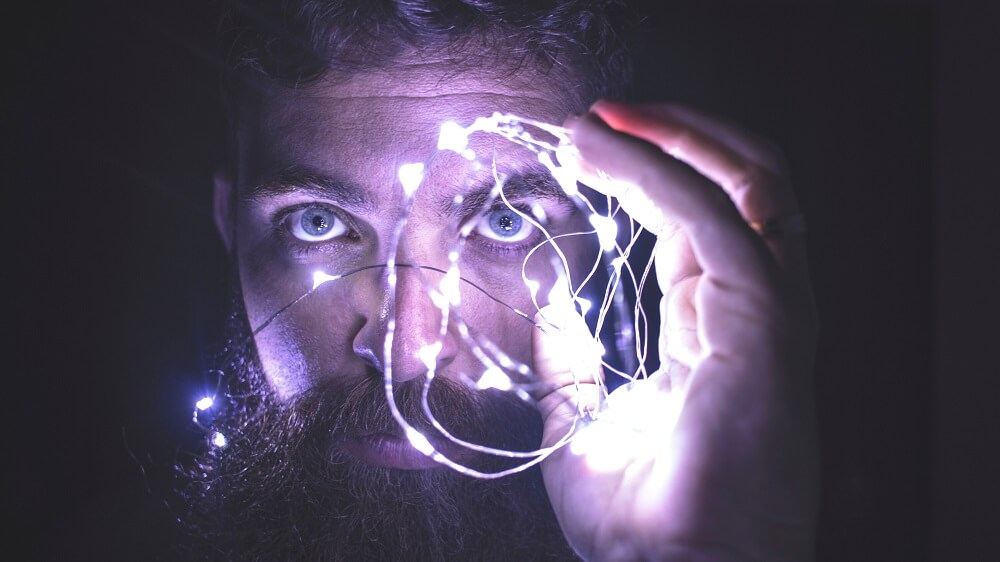 man holding a string of lights, choline as a nootropic featured image