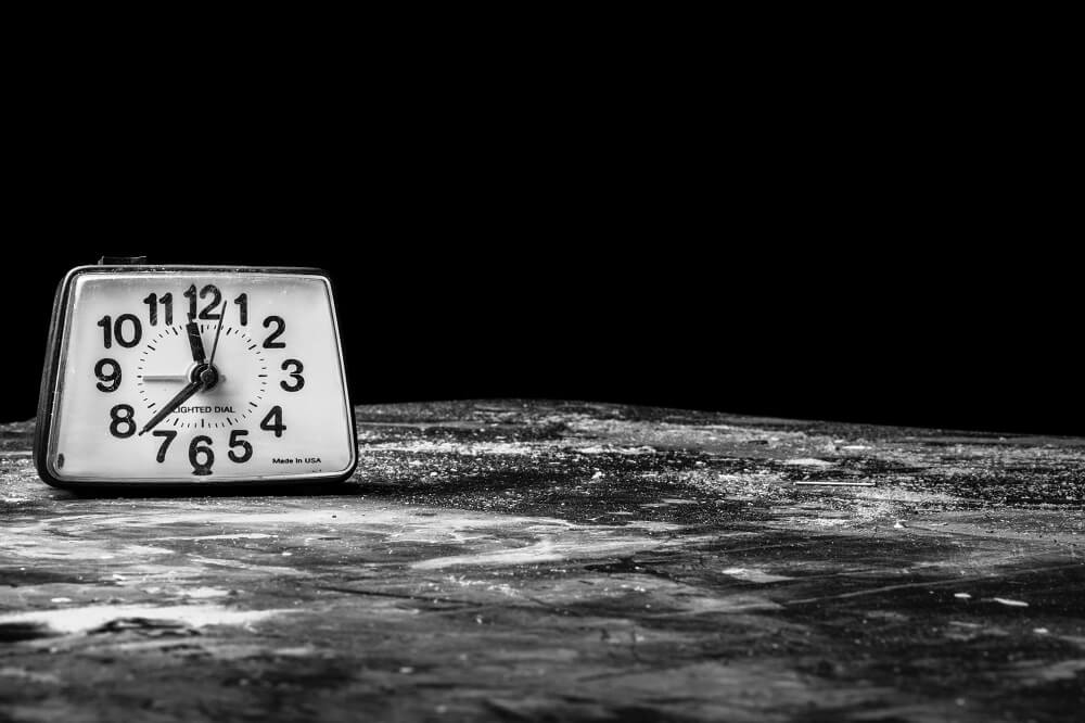 clock in a black and white photo