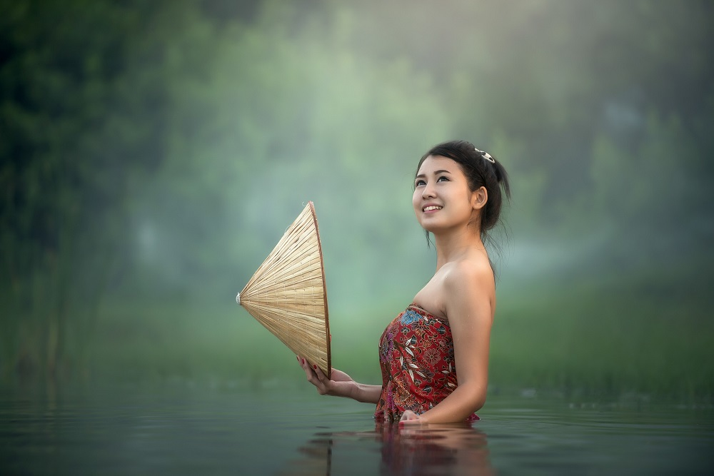 young asian woman in a lake
