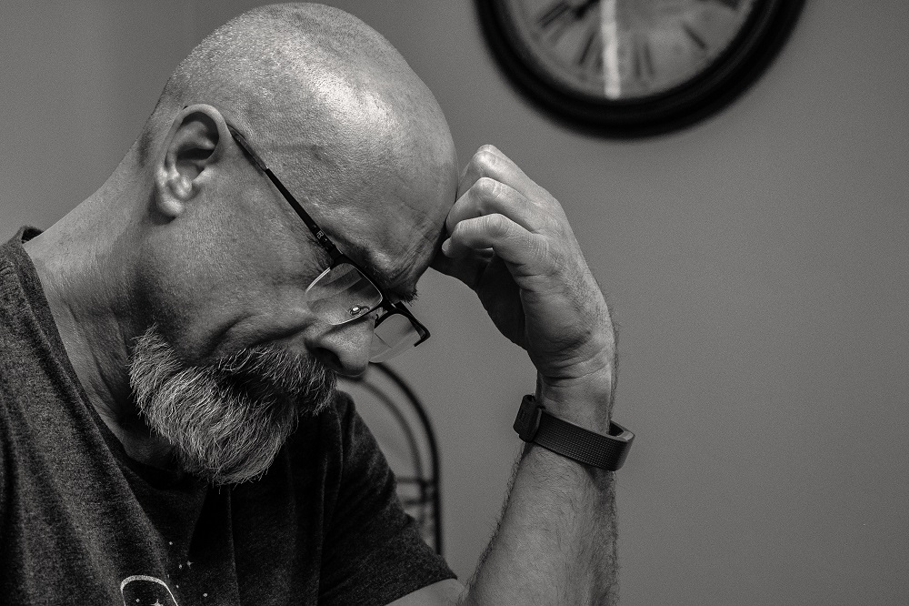 a stressed man in his 60s