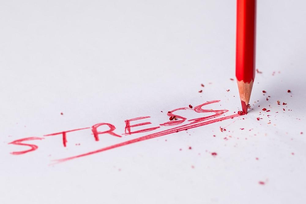 stress text handwritten on a white paper