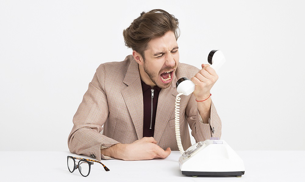 man yelling at the phone